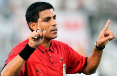 arbitro Enrique Caceres