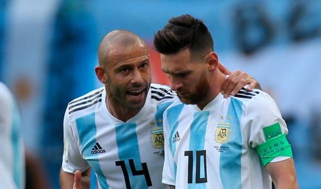 Macherano y Messi